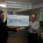 Ivan Powell presents the donation to Noel O'Connell